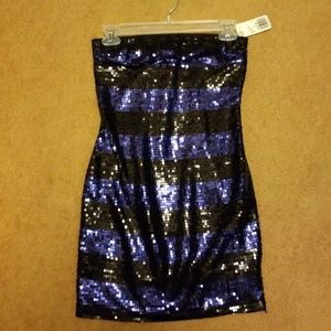Sequined black and purple dress. The back is black